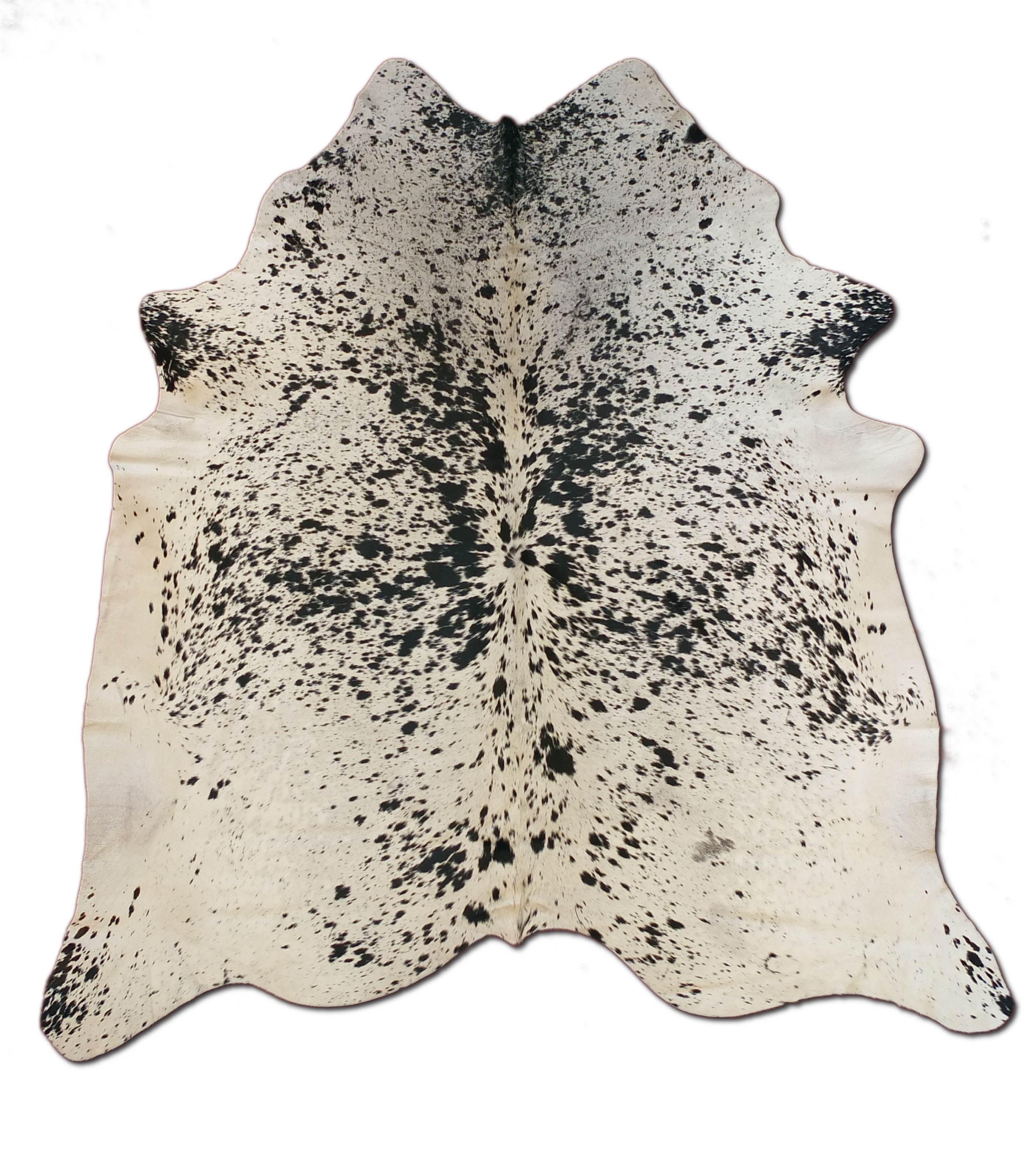 tapis peau de vache gris id es d 39 images la maison. Black Bedroom Furniture Sets. Home Design Ideas